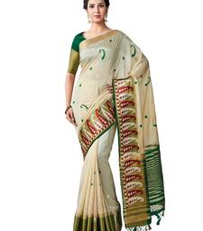 beige embroidered tussar silk saree with blouse
