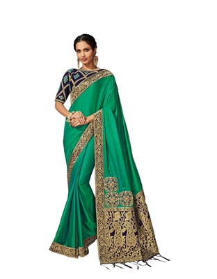 Sea green embroidered silk blend saree with blouse