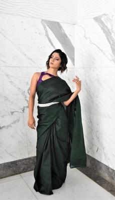 Dark green hand woven silk saree with blouse