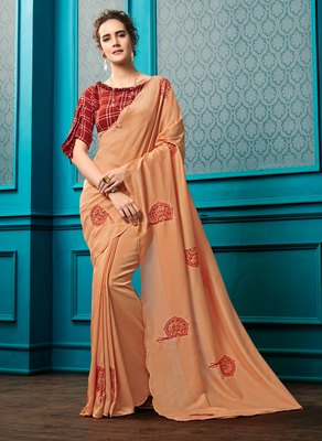 Peach embroidered faux georgette saree with blouse