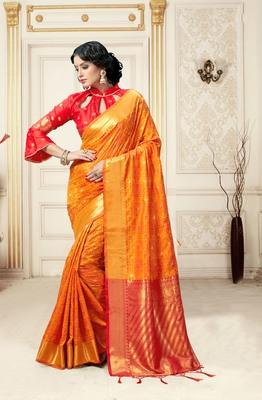 Orange printed kanchipuram silk saree with blouse