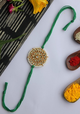 Green Handcrafted Kundan Inspired Rakhi With Pearls