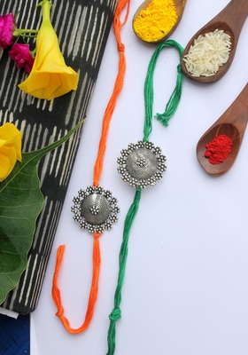 Orange Green Handcrafted Rakhis (Set Of 2)