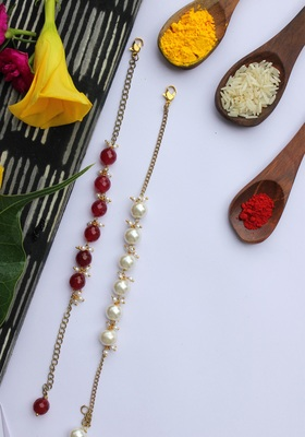 Red White Onyx And Pearls Handcrafted Rakhis (Set Of 2)