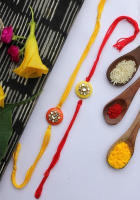 Yellow Red Handcrafted Kundan Inspired Rakhis (Set Of 2)