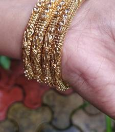 Gold Plated Stone Studded Bangles Set Of 4