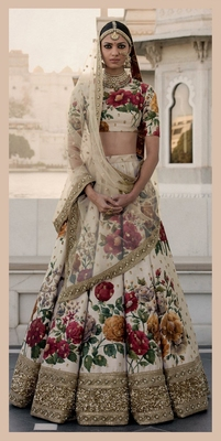Ivory embroidered art silk unstitched lehenga