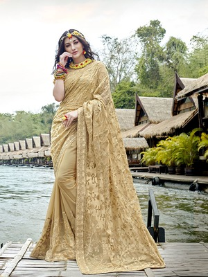 Beige embroidered georgette saree with blouse