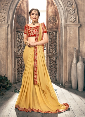 Light yellow embroidered chiffon saree with blouse