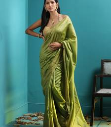 OLIVE GREEN TUSSER MUNGA SAREE WITH ZARI BORDER
