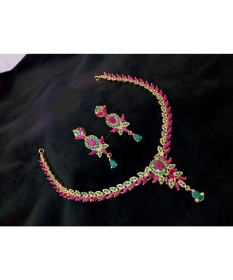 Georgeous gold plated ruby and embroled necklace set