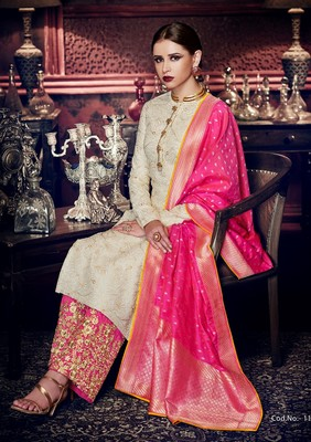 Off white embroidered tussar silk semi stitched salwar with dupatta