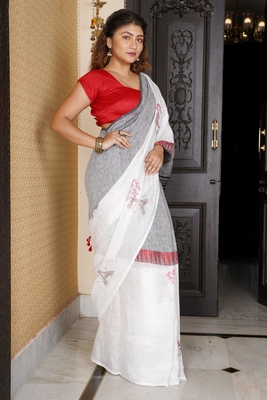 GREY AND WHITE HALF HALF LINEN SAREE WITH MIDDLE BORDER AND EIFFEL TOWER EMBROIDERED MOTIF