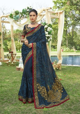 Dark blue embroidered chiffon saree with blouse