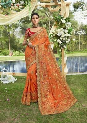 Orange embroidered satin saree with blouse