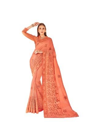Peach woven silk saree with blouse