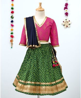 Printed Green Lehenga with Contrast Pink tie back choli and Black Dupatta