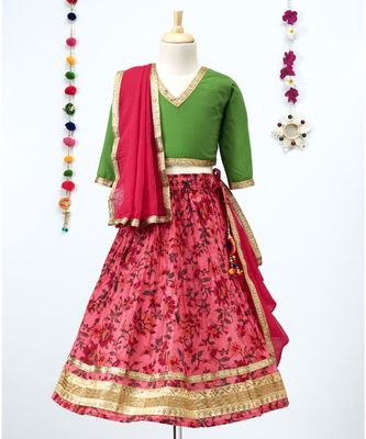 printed Lehenga with contrast green tie back choli and red Dupatta
