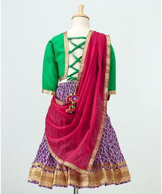 Purple printed Lehenga with contrast green tie back choli and Pink Dupatta