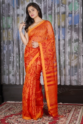 FIREY ORANGE MUSLIN WITH ALL OVER FLORAL WEAVING DESIGN