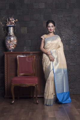 BEIGE AND SKY BLUE BENARASI WITH ZARI WEAVING AND BORDER