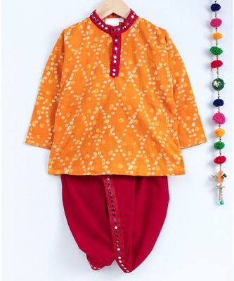 Yellow kurta with red dhoti and mirror work lace