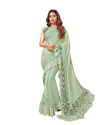 Green embroidered lycra ruffle saree with blouse