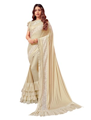 Cream embroidered lycra ruffle saree with blouse