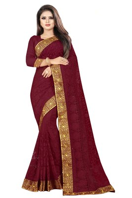 Brown embroidered net saree with blouse