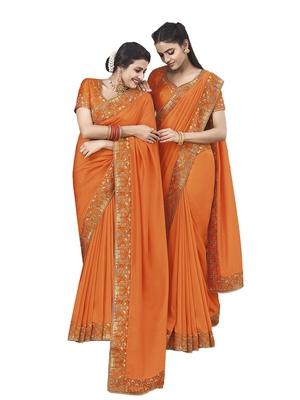 Saffron embroidered satin saree with blouse