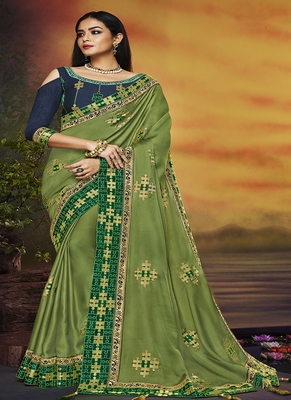 parrot green embroidered silk blend saree with blouse
