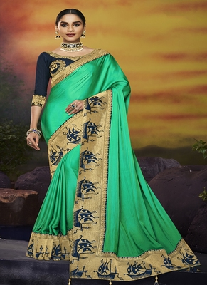 light turquoise embroidered silk blend saree with blouse