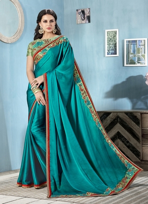 Dark teal embroidered faux chiffon saree with blouse