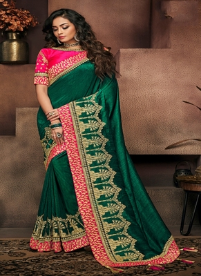 dark green embroidered fancy fabric saree with blouse