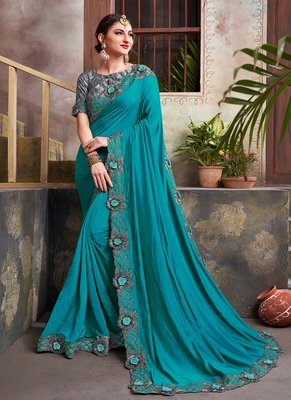 aqua blue embroidered silk blend saree with blouse