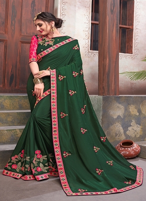dark green embroidered silk blend saree with blouse