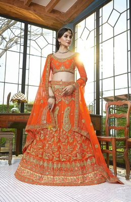 Orange embroidered net semi stitched lehenga