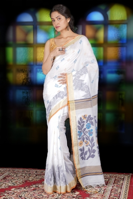 WHITE BLENDED COTTON SAREE WITH ALL OVER FLORAL WEAVING AND BUTA