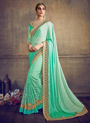 Sea green embroidered chiffon saree with blouse