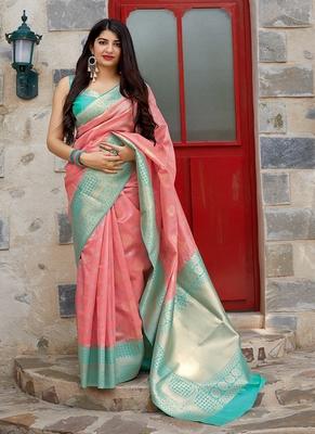light pink woven banarasi silk blend saree with blouse