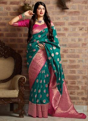 Teal woven banarasi silk blend saree with blouse