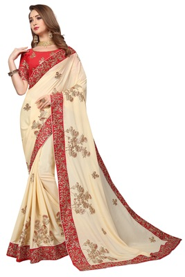 Cream embroidered chiffon saree with blouse