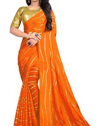 Orange printed faux georgette saree with blouse