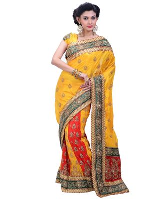 yellow embroidered silk blend saree with blouse