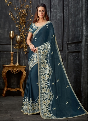 Teal embroidered tissue saree with blouse