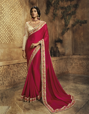 Rani pink embroidered silk blend saree with blouse