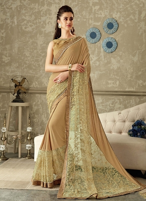 Cream plain lycra saree with blouse