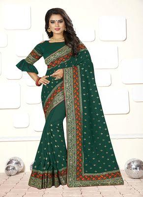 Dark green embroidered art silk saree with blouse