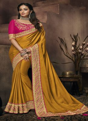 Mustard embroidered satin saree with blouse