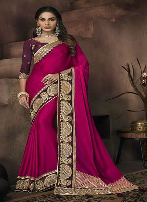 Magenta embroidered satin saree with blouse